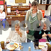 Beck Diefenbach  -  bdiefenbach@daily-chronicle.com<br /> <br /> Voluntary Action Center program director Nancy Hicks shares a laugh with  Linda Simon of DeKalb while serving dinner at the DeKalb Senior Citizens Luncheon Site in DeKalb, Ill., on Wednesday July 1, 2009. VAC has begun serving three free meals a week with money from the federal stimulus package.
