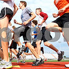 Kyle Bursaw – kbursaw@daily-chronicle.com<br /> <br /> The DeKalb boys cross country team warms up on the track at the start of practice on Friday, Aug. 12, 2011.