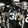 Rob Winner – rwinner@shawmedia.com<br /> <br /> Kaneland's Jesse Balluff (30) returns to the sideline after a touchdown run during the second quarter in Maple Park on Friday, Oct. 28, 2011.