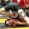 Rob Winner – rwinner@daily-chronicle.com<br /> <br /> DeKalb's Jake Jones (bottom) is held down by Sycamore's Chris Kerwin in the 119-pound match on Thursday, Jan. 13, 2011 in Sycamore, Ill. Kerwin would go on to win the match for Sycamore.