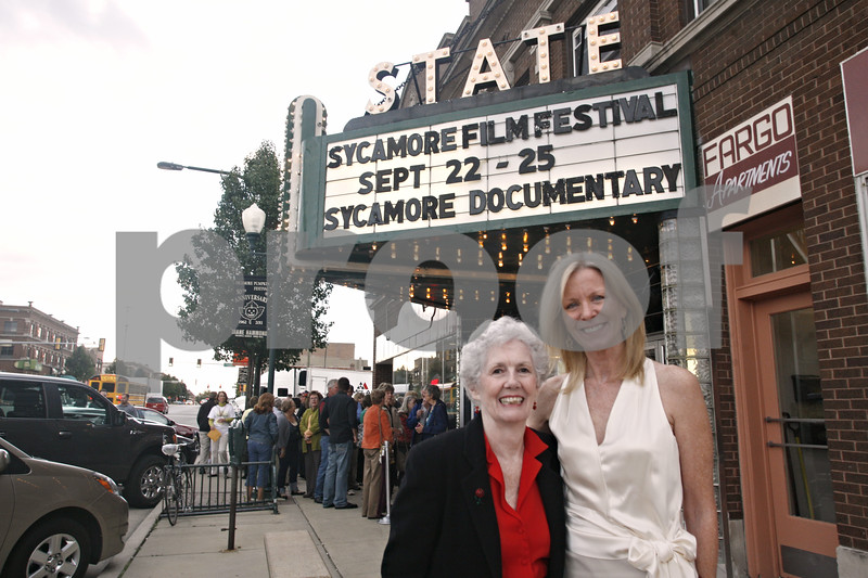 """Doug Oleson – doleson@shawmedia.com<br /> <br /> Filmmaker Susan Hope Engel (right), who made the """"Sycamore"""" documentary, poses with Virginia Poust Wirsing, one of the Sycamore residents who was interviewed for the 45-minute document prior to a special premiere last night. The premiere kicks off the inaugural Sycamore Film Festival, which runs through this weekend."""