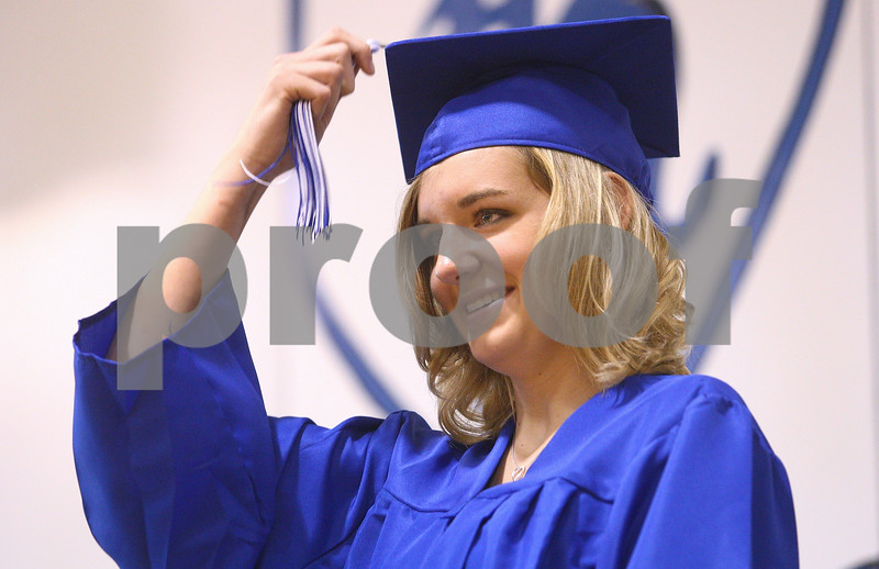 Kyle Bursaw – kbursaw@daily-chronicle.com<br /> <br /> Hinckley-Big Rock senior Tess Godhardt moves her tassel to the other side of her cap on stage during the graduation ceremony on Sunday, May 29, 2011.