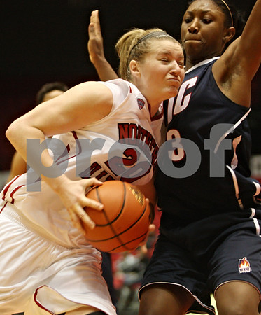 Rob Winner – rwinner@shawmedia.com<br /> <br /> Northern Illinois forward Jenna Thorp (20) drives to the basket as University of Illinois-Chicago Cree Nix (right) defends during the second half in DeKalb, Ill., on Wednesday, December 14, 2011. UIC defeated NIU, 49-47.