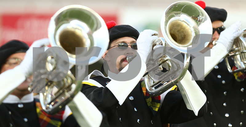 Kyle Bursaw – kbursaw@daily-chronicle.com<br /> <br /> Members of the Kilties from Racine, Wis. perform at Huskie Stadium during a drum and bugle competition on Saturday, July 30, 2011.