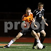 Rob Winner – rwinner@shawmedia.com<br /> <br /> DeKalb's Sammy Lake (2) and Sycamore's Adam Millburg battle for possession during the first half in DeKalb on Tuesday, Sept. 20, 2011.