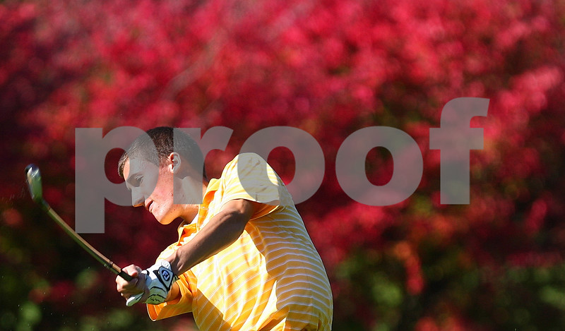 Kyle Bursaw – kbursaw@shawmedia.com<br /> <br /> Sycamore's Kyle Buzzard swings from the fairway on two at Sycamore Golf Club during the IHSA Boys Regional on Tuesday, Oct. 4, 2011.