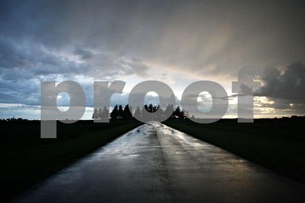 Rob Winner – rwinner@daily-chronicle.com<br /> <br /> Storm clouds begin to clear as the last moments of daylight can be seen as the sun sets after the first day of summer near Greenwood Cemetery in Hinckley on Tuesday evening.