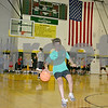 Maria Wright, 10, of Sycamore, dribbles a basketball Monday in the Sycamore High School gym for the Chicago Bulls Basketball Schools day camp. <br /> <br /> Caitlin Mullen - cmullen@daily-chronicle.com