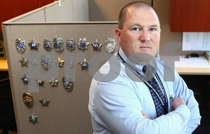 Kyle Bursaw – kbursaw@daily-chronicle.com<br /> <br /> Detective Daniel Hoffman collects police badges and currently has around 40 different badges.<br /> <br /> Wednesday, June 29, 2011.