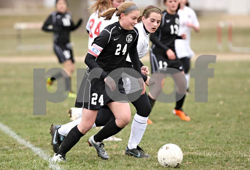 Rob Winner – rwinner@daily-chronicle.com<br /> <br /> Kaneland's Emily Heimerdinger (24) looks to shoot during the first half on Monday, April 4, 2011, in Waterman, Ill. Kaneland defeated Indian Creek, 5-0.