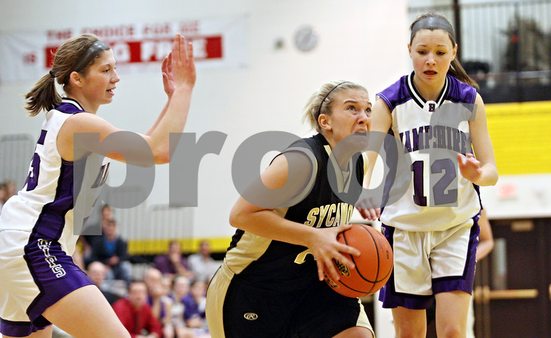 Rob Winner – rwinner@daily-chronicle.com<br /> <br /> Sycamore's Kelcee Miller goes to the basket during the third quarter in Sycamore, Ill.,  on Wednesday, Feb. 16, 2011. Hampshire would go on to defeat Sycamore, 57-41, during the IHSA Class 3A Sycamore Regional.