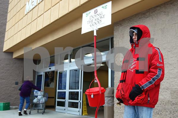 Kyle Bursaw – kbursaw@shawmedia.com<br /> <br /> Josue Gonzalez rings a bell next to the Salvation Army red kettle outside Wal-Mart in DeKalb, Ill. on Thursday, Dec. 15, 2011.