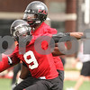 Kyle Bursaw – kbursaw@daily-chronicle.com<br /> <br /> Jordan Delegal does a spin move to get around a teammate during a drill. Delegal wore a no. 9 jersey instead of his usual no. 29 as a tribute to Devon Butler during practice at Huskie Stadium on Saturday, April 9, 2011. Butler is in the hospital after being shot in his back earlier in the week.
