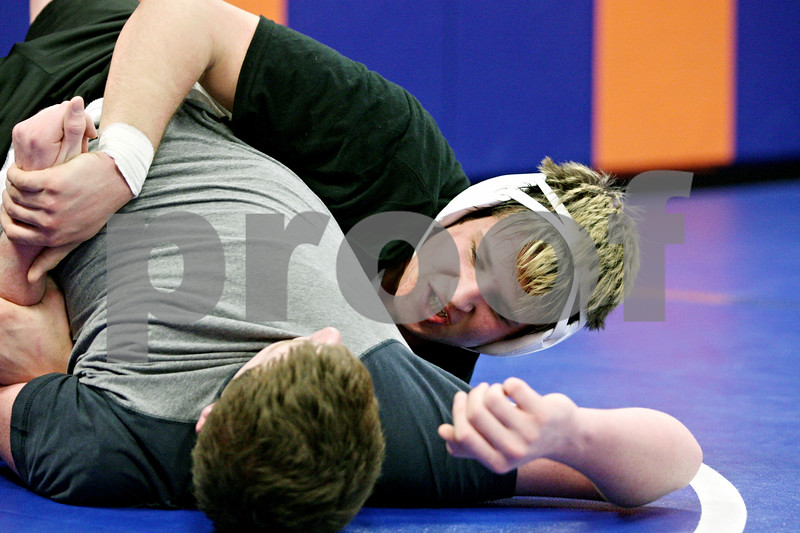 Rob Winner – rwinner@daily-chronicle.com<br /> <br /> Clay Chaberski (right) of the Genoa-Kingston wrestling team practices with Sean Jursich on Tuesday, Feb. 8, 2011 in Genoa, Ill.