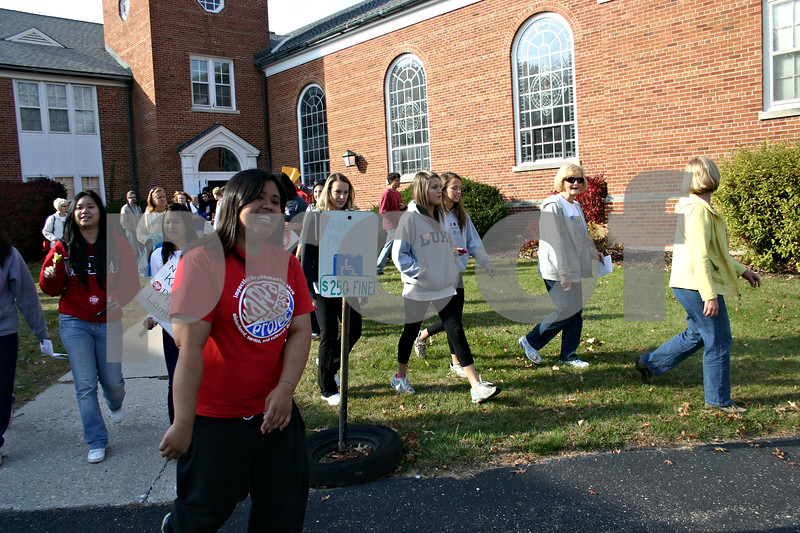 Jeff Engelhardt – Dozens of people spill out of First Congretional United Church of Christ in DeKalb Sunday as they get ready for the four-mile walk as part of the 2011 CROP Hunger Walk. NIU organizations such as Kappa Phi Lambda made the event one of the biggest ever in its 60-plus year history.
