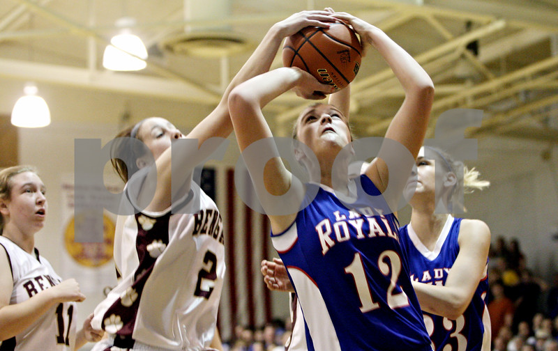 Rob Winner – rwinner@daily-chronicle.com<br /> <br /> Hinckley-Big Rock's Katie Hollis (12) has her shot blocked by a St. Benedict defender during the first quarter of the IHSA Class 1A H-BR Sectional final in Hinckley, Ill., on Thursday February 17, 2011. Hinckley-Big Rock went on to defeat St. Benedict, 63-25.