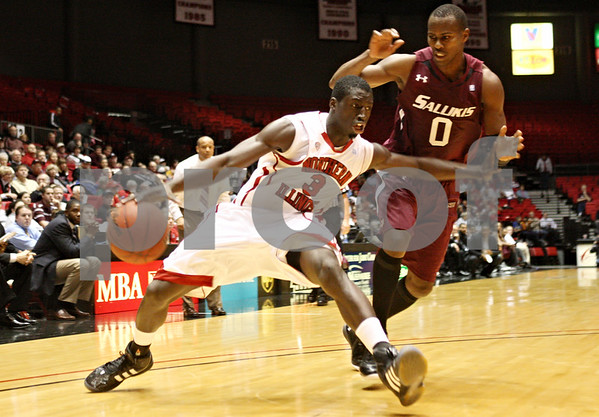 Rob Winner – rwinner@shawmedia.com<br /> <br /> Northern Illinois guard Antone Christian (3) fakes a move to the basket before setting his feet for a two-point shot during the second half in DeKalb, Ill., on Saturday, Dec. 17, 2011. SIU defeated NIU, 62-49.