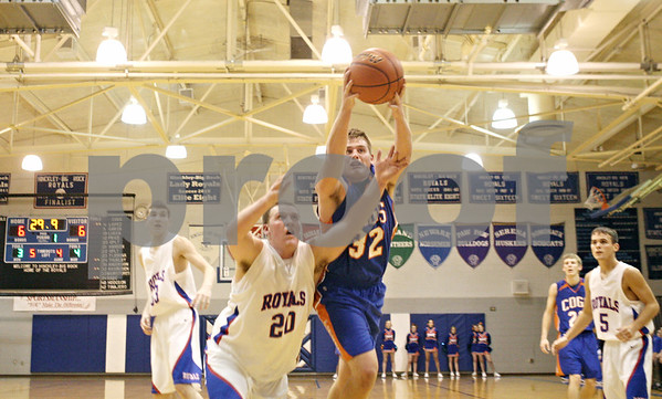 Rob Winner – rwinner@shawmedia.com<br /> <br /> Hinckley-Big Rock's Zack Michels (20) and Genoa-Kingston's Matthew Rasmussen (32) try to control a rebound during the first quarter in Hinckley, Ill., on Monday, Dec. 19, 2011. H-BR defeated G-K, 58-40.
