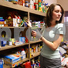 Kyle Bursaw – kbursaw@daily-chronicle.com<br /> <br /> Emily Martin looks back at a box of donations while deciding what items to add to it. Martin and several other employees at the Foster & Buick Law Group in Sycamore, Ill. were boxing up a conference room lined with donated goods on Tuesday, March 29, 2011.