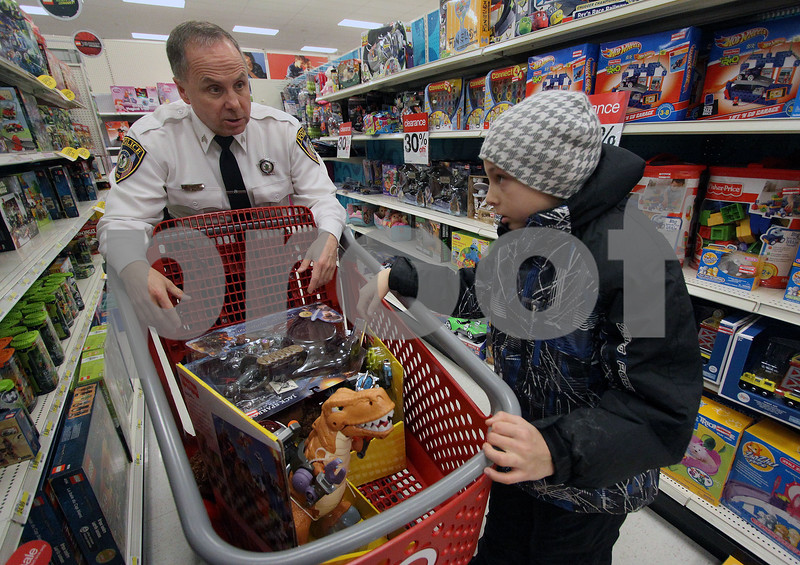 Wendy Kemp - For The Daily Chronicle<br /> Sgt. Tracy Smith helps Jacob Day, 9, with his toy selection during the Shop with a Cop event at Target on Sunday.<br /> DeKalb 12/11/11