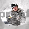 Kyle Bursaw – kbursaw@daily-chronicle.com<br /> <br /> Northern Illinois student Chad Bushue works on digging a tunnel in a snow bank near Huskie Stadium in DeKalb, Ill. on Wednesday, Feb. 2, 2011. Bushue and his friends intend to dig out an area big enough to all fit into.