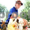 Kyle Bursaw – kbursaw@daily-chronicle.com<br /> <br /> Mary Nehring, an intern with non-profit Tanzania Development Support, packs up the merchandise for sale at her display after a slow afternoon at the Lincoln Highway Buy-Way yard sale on Eleventh Street, just south of State Street in DeKalb, Ill. on Thursday, Aug. 4, 2011.