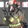 Kyle Bursaw – kbursaw@daily-chronicle.com<br /> <br /> Lt. Shaun Penn, runs a charged line of hose through Station no. 2 in Sycamore, Ill. on Thursday, Feb. 24, 2011. Penn recently returned from serving the military in Afghanistan. After about a year away from being a firefighter, Penn spent a lot of time in his first week reacquainting himself with critical techniques of the job, before returning to normal shifts.