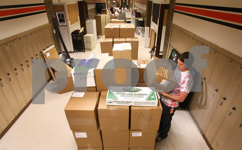 Kyle Bursaw – kbursaw@daily-chronicle.com<br /> <br /> David Dinkins, loads boxes onto a pallet at the former DeKalb High School, on fourth street, to be transported to the new DeKalb High School on Tuesday, June 7, 2011.