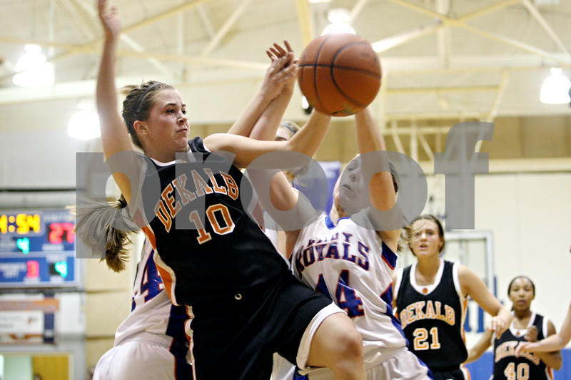 Rob Winner – rwinner@daily-chronicle.com<br /> <br /> DeKalb's Alli Smith (10) and Hinckley-Big Rock's Kaitlin Phillips (14) struggle for a loose ball under the Barbs' basket during the fourth quarter of their game in Hinckley, Ill., on Monday, February 7, 2011.