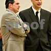 Rob Winner – rwinner@daily-chronicle.com<br /> Sycamore coach Jeff Hilmer (left) and Kaneland coach Brian Johnson meet before the start of the boys game.
