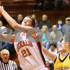 Kyle Bursaw – kbursaw@daily-chronicle.com<br /> <br /> DeKalb's Kelli Gerace snags a rebound over Sterling defenders in the second quarter of their game in DeKalb, Ill. on Saturday, Jan. 29, 2011.