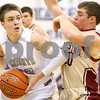 Kyle Bursaw – kbursaw@shawmedia.com<br /> <br /> Kaneland's Tyler Heinle prepares to shoot as Morris' Jake Hogan defends during the third quarter of their game in the Plano Christmas Classic in Plano, Ill. on Tuesday, Dec. 27, 2011. The Knights defeated the Redskins 50-44.