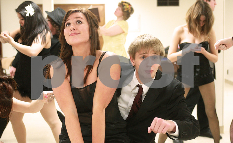 """Kyle Bursaw – kbursaw@daily-chronicle.com<br /> <br /> Nikki Hambly (left) and Patrick Price (right) rehearse a scene in """"Chicago"""" as their characters Roxie Hart and Billy Flynn."""