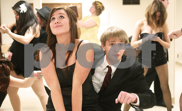 "Kyle Bursaw – kbursaw@daily-chronicle.com<br /> <br /> Nikki Hambly (left) and Patrick Price (right) rehearse a scene in ""Chicago"" as their characters Roxie Hart and Billy Flynn."