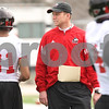 Kyle Bursaw – kbursaw@daily-chronicle.com<br /> <br /> Huskies coach Dave Doeren observes his players during practice at Huskie Stadium on Saturday, April 9, 2011.