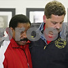 Rob Winner – rwinner@shawmedia.com<br /> <br /> Dr. Larry D. Bolles (left), a representative of the Northern Illinois University Office of Community Standards and Student Conduct, is consoled by DeKalb Fire Chief Bruce Harrison after a press conference at the DeKalb City Hall that addressed the shooting that killed NIU student Steven Agee II the morning of Wednesday, Nov. 23, 2011, in DeKalb, Ill.