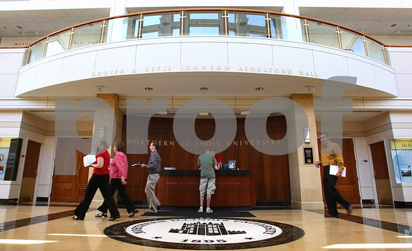 Kyle Bursaw – kbursaw@daily-chronicle.com<br /> <br /> People walk past the information desk inside the Barsema Alumni and<br /> Visitors Center where NIU student Jonathan Cummins helps a guest on Tuesday, July 5, 2011.