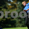 Kyle Bursaw – kbursaw@shawmedia.com<br /> <br /> Genoa-Kingston's Matt Rasmussen swings from the fairway of four at Sycamore Golf Club during the IHSA Boys Regional on Tuesday, Oct. 4, 2011.