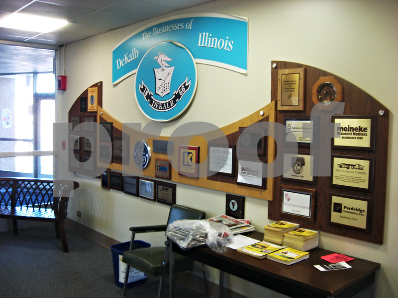ANDREW MITCHELL – amitchell@shawmedia.com<br /> A wall dedicated to the various businesses at the DeKalb Municipal Building, at 200 S. Fourth Street, is being updated after going unchanged for several years.