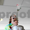 Rob Winner – rwinner@shawmedia.com<br /> <br /> Jeremy Benson holds up a rose that was dipped in liquid nitrogen during a demonstration at STEMfest at the Convocation Center at Northern Illinois University in DeKalb on Saturday, Oct. 22, 2011. STEMfest seeks to increase public awareness of science, technology, engineering, and math (STEM) initiatives, activities, careers, and education for the people of northern Illinois.