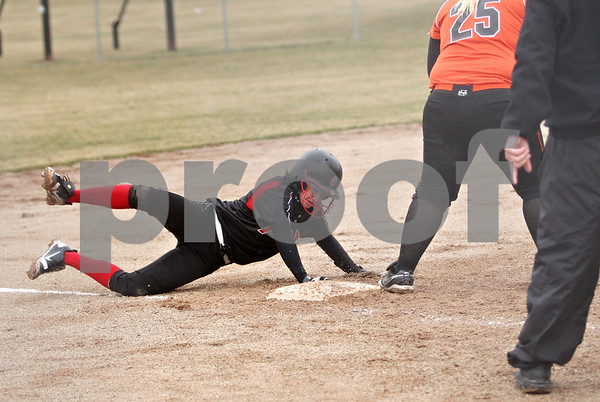 Rob Winner – rwinner@daily-chronicle.com<br /> <br /> Indian Creek's Anna Stiker slides safely into third base after a triple during the top of the second inning in DeKalb, Ill., on Wednesday, March 23, 2011. DeKalb went on to defeat Indian Creek in five innings, 16-4.