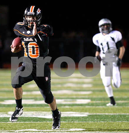 Kyle Bursaw – kbursaw@shawmedia.com<br /> <br /> DeKalb defensive back Brian Sisler runs in an interception for a touchdown as Kaneland wide receiver Zack Martinelli chases during the second quarter of the game in DeKalb, Ill. on Friday, Sept. 30, 2011.