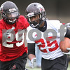 Kyle Bursaw – kbursaw@daily-chronicle.com<br /> <br /> Linebacker Jordan Delegal (29) chases down Jasmin Hopkins (25) during practice at Huskie Stadium on Tuesday, March 22, 2011.