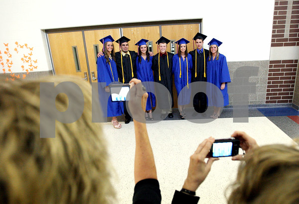 Rob Winner – rwinner@daily-chronicle.com<br /> <br /> Family members take photographs of Genoa-Kingston graduating seniors in a hallway outside the gymnasium before the commencement ceremony on Wednesday in Genoa.
