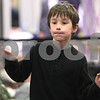 Kyle Bursaw – kbursaw@daily-chronicle.com<br /> <br /> Matthew Sharp, 7, plays with a Kinect for Xbox 360, a video game device that detects your physical movements, at the Best Buy table at the Community Expo. The expo was held at Sycamore high school on Tuesday, March 22, 2011.