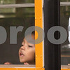 Kyle Bursaw – kbursaw@shawmedia.com<br /> <br /> Two children gaze out the window of one of District 428's buses as it makes a stop on the morning of Thursday, Sept. 29, 2011.