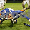 Rob Winner – rwinner@shawmedia.com<br /> <br /> Genoa-Kingston's Calvin Beach is tackled after a reception during the second quarter in Genoa, Ill. on Friday, Sept. 30, 2011.