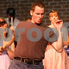 Kyle Bursaw – kbursaw@daily-chronicle.com<br /> <br /> Kenickie, played by Tim Karkowski, tries his best during the dance competition in the second act of Grease during a rehearsal for Stage Coach Players production on Tuesday, July 5, 2011.