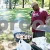 Rob Winner – rwinner@shawmedia.com<br /> <br /> Jerry Wright, of DeKalb, begins grilling chicken for his family during a picnic at Hopkins Park on Monday afternoon.