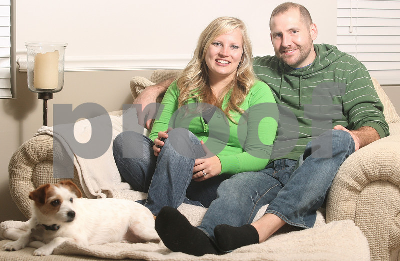 Kyle Bursaw – kbursaw@daily-chronicle.com<br /> <br /> Kyla Rader and Brent Hueber, pictured here with their dog Marley, have their July wedding all planned out.<br /> <br /> Tuesday, March 1, 2011.